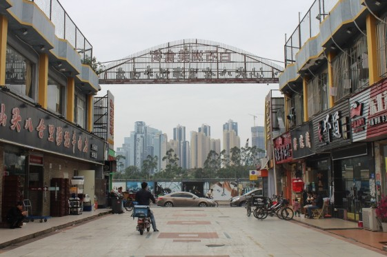 The urban village in Shenzhen in contrast with the high-rise buildings in the back